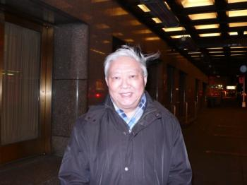 World renowned artist Lefu Gu watches the Shen Yun on Feb. 13, Chinese New Year's Eve at the Radio City Music Hall in New York. (The Epoch Times)