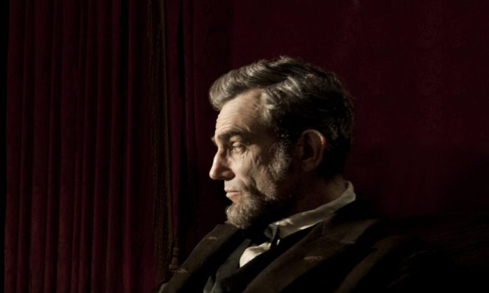 """Daniel Day-Lewis (as President Abraham Lincoln) in a scene from the dramatic historical biography """"Lincoln,"""" a film about Abraham Lincoln's struggle in the Civil War and the fighting in his cabinet over the decision to emancipate slaves. (David James/ DreamWorks II Distribution Co., LLC.)"""