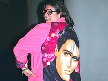 Linda Martin models her Elvis coat. (Mary Silver/The Epoch Times)