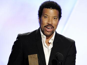 Lionel Richie, here performing at the Noble Awards, and Quincy Jones may be teaming up for a 25th anniversary remake of 'We are the World.' (Kevin Winter/Getty Images for The Noble Awards)