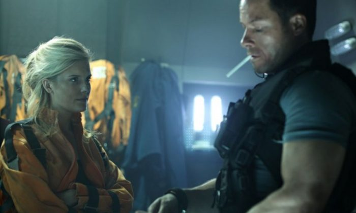 Maggie Grace and Guy Pearce in the science fiction action-thriller 'Lockout,' a film about a wrongly convicted man who is offered freedom if he can save the president's daughter from an outer-space prison. (Open Road Films)