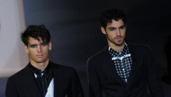 Designs from the Giorgio Armani collection shown on June 22 in Milan featured rumpled trousers and contrasting lines on the shirts. (Giuseppe Cacace/AFP/Getty Images)