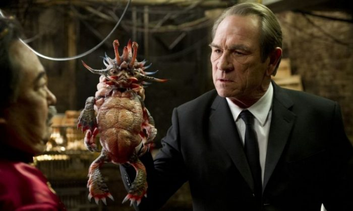 Keone Young (L) and Tommy Lee Jones holding Spiky Bulba in the sci-fi action-comedy 'Men In Black 3.' (Wilson Web/ Columbia Pictures Industries, Inc)