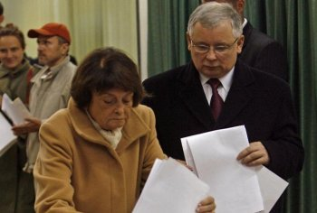 Polish Prime Minister Jaroslaw Kaczynski watches and his mother Jadwiga cast her ballot at a polling station in Warsaw for the general elections 21 October 2007. Jaroslaw told his mother Wedneday that his twin President Lech Kaczynski, was killed in a pla (Janek Skarzynski/Getty Images)