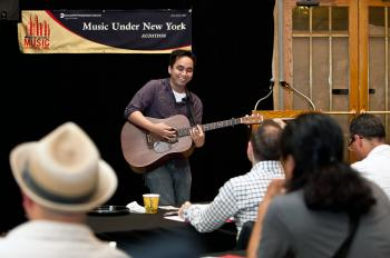 SINGER SONGWRITER: Musician Jay Legaspi auditioning at Grand Central Terminal on Tuesday.  (Amal Chen/The Epoch Times)