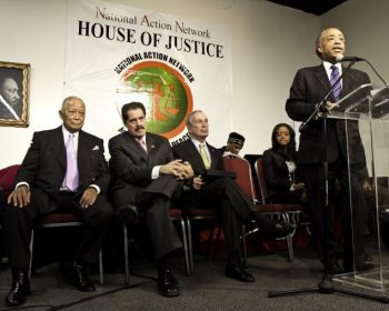 REV. REMEMBERS: The Rev. Al Sharpton commemorates Martin Luther King Jr. Day with a discussion of how to address violence according to the ideals left by Dr. King. Former Mayor David Dinkins (L) and Mayor Michael Bloomberg (R) sit behind him. (Phoebe Zheng/The Epoch Times)