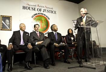 GUN VIOLENCE: Mayor Michael Bloomberg (R) takes part in a discussion of violence in the city hosted by the Rev. Al Sharpton (2nd R) on Martin Luther King Jr. Day. Former Mayor David Dinkins (L) sits behind before giving his input on the subject.  (Phoebe Zheng/The Epoch Times)