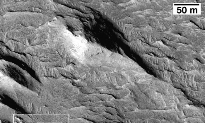 Wind-eroded yardangs composed of materials from the lower member of the Medusae Fossae Formation. (Image courtesy of NASA/JPL/University of Arizona)