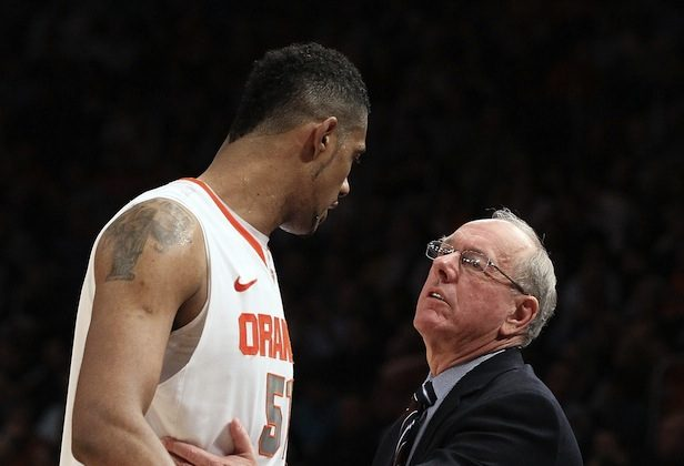 Jim Boeheim's (R) Orange went 29-1 with Fab Melo (L) in the lineup this season and 2-1 without him. (Jim McIsaac/Getty Images)
