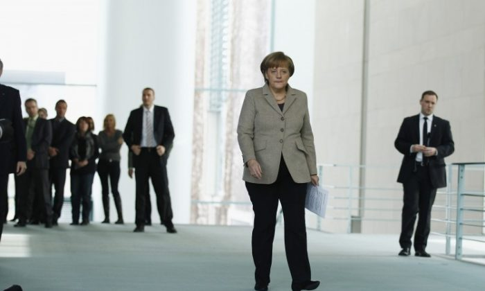 German Chancellor Angela Merkel arrives for a statement to Wulff's resignation at Chancellery (Bundeskanzleramt) on February 17, 2012 in Berlin, Germany. German President Christian Wulff is resigning following the launch of investigations by a state prosecutor into possible illegal benefits Wulff received from businessmen while Wulff was governor of Lower Saxony. (Photo by Andreas Rentz/Getty Images)
