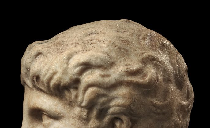 Ancient Greek head of a young man, profile. (Merrin Gallery)
