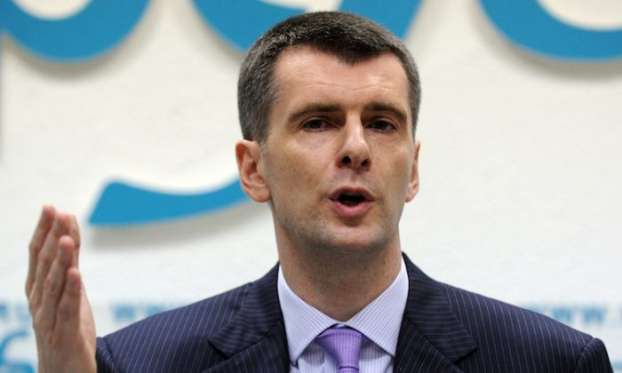 Russian metals tycoon and NBA team owner Mikhail Prokhorov plans to run for Russian president against Vladimir Putin in next year's election. (Yuri Kadobnov/AFP/Getty Images)
