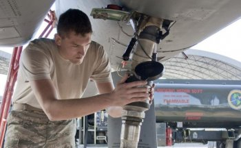 Senior Airman Jacob Prine checks the fuel connection to a F-15 Eagle on Oct. 22, 2010, prior to a flight test of new, environmentally-friendly fuel. The Air Force is working toward changing half of the continental U.S. jet fuel requirement to alternative  (U.S. Air Force photo/2nd Lt. Andrew Caulk)