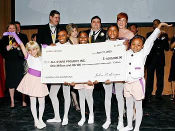 FUNDRAISING FOR KIDS: John and Madlyn Singer, Art Advisors, LLC (4th and 6th from left) present $1,000,000 check to youth of the All Stars Project at the 2009 gala benefit at the Lincoln Center. All Stars Project president and CEO Gabrielle L. Kurlander (2nd L) accepts the check with All Stars Project Hall of Fame honorees. (Erroll Anderson)