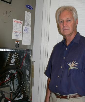 Gary Schultheis stands next to the blackened coils of an air conditioning unit in his Parkland, Florida, home. Schultheis and his wife, Mary Ann, traced their health problems and the chemical smell permeating their home to tainted Chinese drywall.  (Linda Li/The Epoch Times)