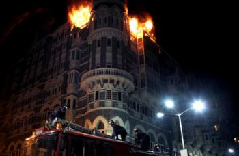 Fire brigade personnel arrive as fire engulfs the top floor of the Taj Mahal hotel, site of one of the shootouts with terrorists in Mumbai.  (Lorenzo Tugnoli/AFP/Getty Images)
