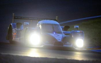 Nicolas Minassian drives the #2 Peugeot as night falls over the 78th edition of the 24 Hours of Le Mans. (Jean Francois Monier/AFP/Getty Images)