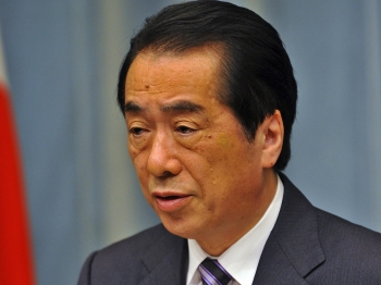 DOWNPLAYING DANGER? Japanese Prime Minister Naoto Kan speaks to the press on April 12 at his office in Tokyo. Kan said the situation at the Fukushima nuclear plant is gradually stabilizing and the amount of radiation being released is declining. Some say the Japanese government has downplayed the danger of the radiation spewing from the plant.   (Yoshikazu Tsuno/Getty Images)