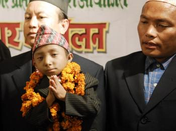 Nepalese teenager Khagendra Thapa Magar (front) gestures to journalists during a press conference in Kathmandu on Feb. 21.  (Prakash Mathema/AFP/Getty Images)