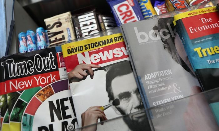 Newsweek Magazine sits for sale at a news stand in New York City. Tina Brown, editor-in-chief of The Newsweek Daily Beast Co, announced on Oct. 18, 2012, that the 80-year-old news magazine will publish its final print edition on December 31 and shift to an all-digital format in early 2013. Staff layoffs are expected. (John Moore/Getty Images)