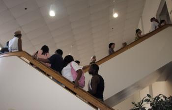 SEEKING MORTGAGE COUNSELING: Many people lined up on the stairway to enter the Foreclosure Prevention Fair, Saturday, June 27, at the Ernst Community Cultural Center on the Annandale campus of Northern Virginia Community College. (Terri Wu/The Epoch Times)