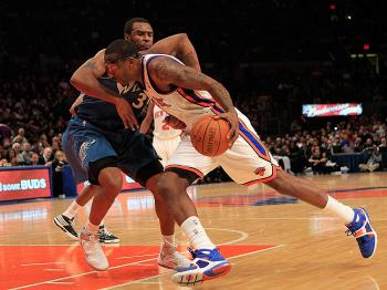POWER THROUGH: Amar'e Stoudemire drives past Trevor Booker in Monday night's match-up between the New Yorks Knicks and Washington Wizards. (Chris Trotman/Getty Images)