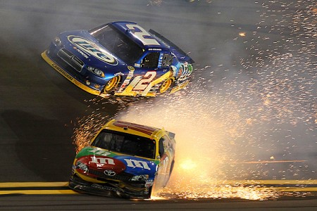 Kyle Busch, driver of the #18 M&M's Brown Toyota, fights to stave off a wreck during the NASCAR Budweiser Shootout at Daytona International Speedway. (Matthew Stockman/Getty Images)