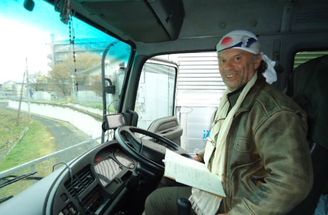 Japan expert John Craig in the four-ton truck he drove from Tokyo to Onagawa carrying relief supplies following the earthquake and tsunami last March. (Courtesy of John Craig)