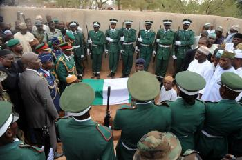PAYING RESPECTS: Senior military officers and guards pay respect to late Nigerian President Umaru Musa Yar'Adua before his burial at the cemetery in Katsina on May 6. (Pius Utomi Ekpei/AFP/Getty Images)