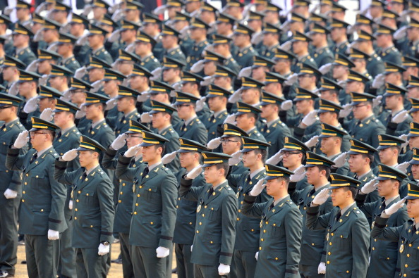 South Korean new officers salute during the joint commission ceremony of 5,780 new officers in Gyeryong, South Korea on March 8. New and ongoing military drills with South Korean and U.S troops have sparked threats from North Korea. (Kim Jae-Hwan/AFP/Getty Images)