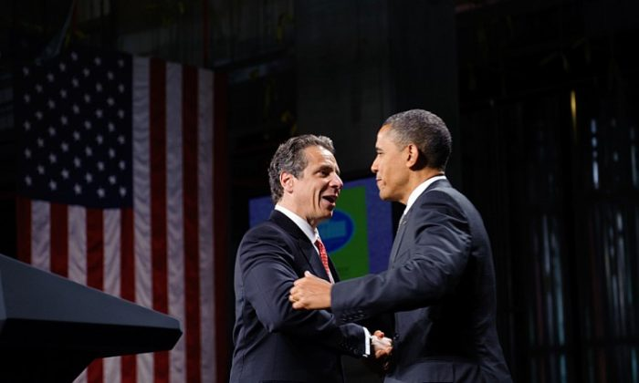 President Barack Obama (R) embraces New York Governor Andrew Cuomo (L) after introducing him in a speech on Tuesday at the State University of New York Albany.(MANDEL NGAN/AFP/GettyImages)