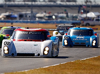 Scott Dixon in the #02 Telmex Ganassi Riley BMW took the lead in the Grand Am Rolex 24 after Joey Hand hit a tire leaving the pits. (Chris Graythen/Getty Images)