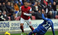 Arsenal Edges Wigan for Third Straight Win