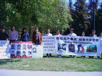 Human rights groups at The Huntington Library on Apr. 5 protest renewal of a sister city agreement with Xicheng district in China without human rights considerations. (The Epoch Times)