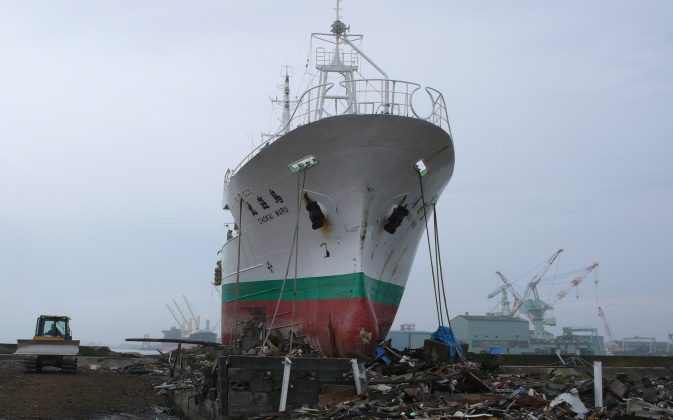 The March 11 tsunami in Japan deposited a 452-ton tuna boat in a coastal neighborhood in Higashimatsushima, Miyagi Prefecture. Even eight months later, the ship has not yet been removed. (Cindy Drukier/The Epoch Times)