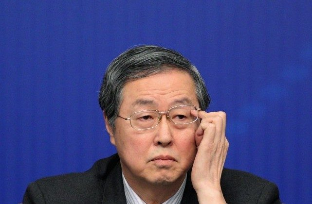 Zhou Xiaochuan, governor of the People's Bank of China, attends a press conference of the Fifth Session of the 11th National People's Congress focusing on monetary policy and financial issues on March 12 in Beijing. The majority of the People's Bank of China's stock is considered non-tradable stock and still owned by various official institutions, raising questions about their degree of separation from communist authorities. (Feng Li/Getty Images)