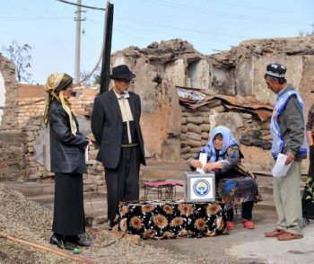 Ethnic Uzbeks vote near their homes in the city of Osh, which was destroyed amid ethnic violence and political unrest earlier this year.  (Victor Drachev/AFP/Getty Images)