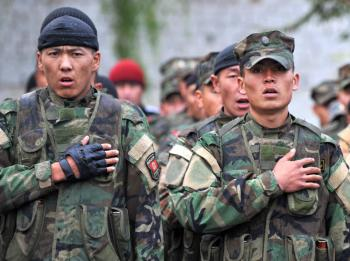 Kyrgyz soldiers near a polling station in the city of Osh during parliamentary election in Kyrgyzstan.  (Victor Drachev/AFP/Getty Images)