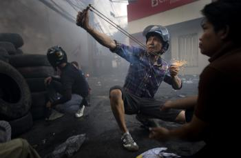 Thai security forces take position as the violence in central part of the city escalates on in Bangkok, Thailand. (Athit Perawongmetha/Getty Images)