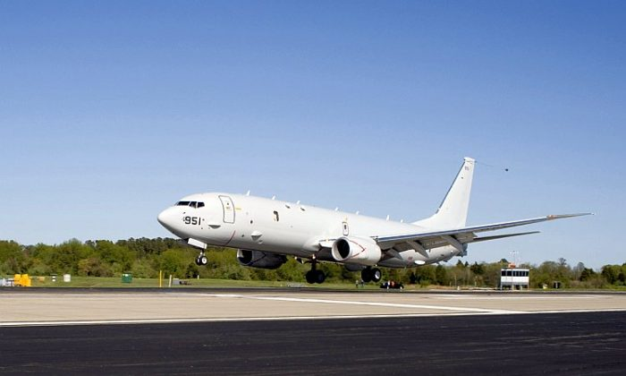 The U.S. Navy's newest maritime patrol and reconnaissance aircraft, the Boeing P-8A Poseidon, touches down at Naval Air Station Patuxent River, Md., April 2010. Counterfeit parts were discovered in the Poseidon's critical ice-detection system. (U.S. Navy photo)
