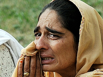 A Pakistani woman weeps for her injured relative after the suicide attack as she awaits for permission to visit him at the Pakistan Ordnance Factory hospital in Wah on Aug. 21.      (Farooq Naeem/AFP/Getty Images)