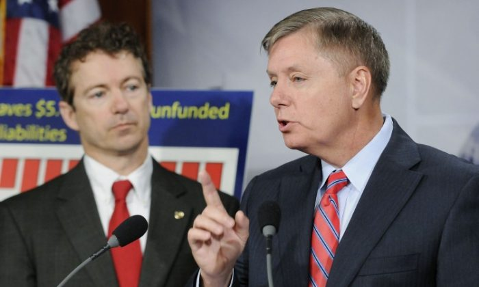 Sen. Rand Paul (R-Ky.) (L) and Sen. Lindsey Graham (R-S.C.) at the U.S. Capitol in this file photo. Graham and other senators voted down on Saturday Paul's proposal to cut off funding for Pakistan, Libya, and Egypt. (Jonathan Ernst/Getty Images)