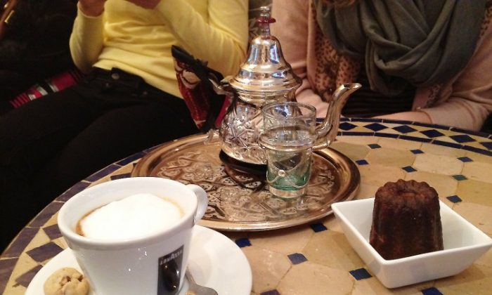 A moment at the Pause Cafe, a Moroccan-themed tea shop and bakery, located at 3 Clinton Street, New York, New York, 10002. Pot of Moroccan Mint Tea ($2.50), Macchiato ($2.50), Canelé ($2.00). (Derek Ku/The Epoch Times)
