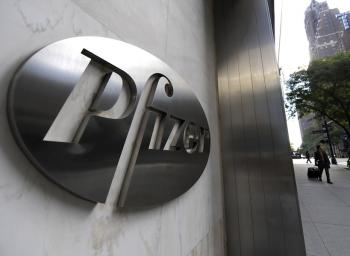 Pharmaceutical company Pfizer is displayed on 42 Street in New York. Pfizer Inc. on Tuesday announced that it would shut down 8 plants around the world, slashing 6,000 total jobs in its ffort to cut down on payroll expense.  (Timothy A. Clary/Getty Images)