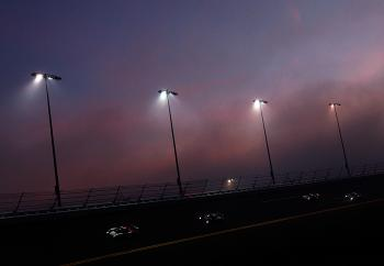 The Daytona Prototypes circulate slowly through the fog, waiting for dawn and a return to racing. (Sam Greenwood/Getty Images)