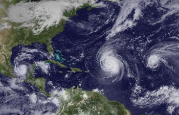 Hurricanes Karl, Igor, and  Julia  (from left to right on Sept. 16) were part of the onslaught of Atlantic storms this season.  (Courtesy of NOAA)