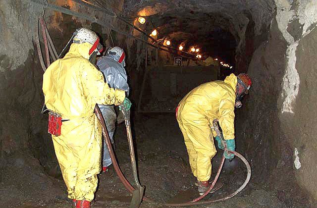 Workers remove mercury contaminated sediments from the Polar Star Mine Superfund site in this file photo. The EPA added two new sites to its priority cleanup list last week. (Courtesy of EPA.gov)