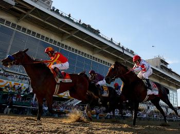 Lookin at Lucky, First Dude and Jackson Bend cross the finish line in the Preakness. (Matthew Stockman/Getty Images)