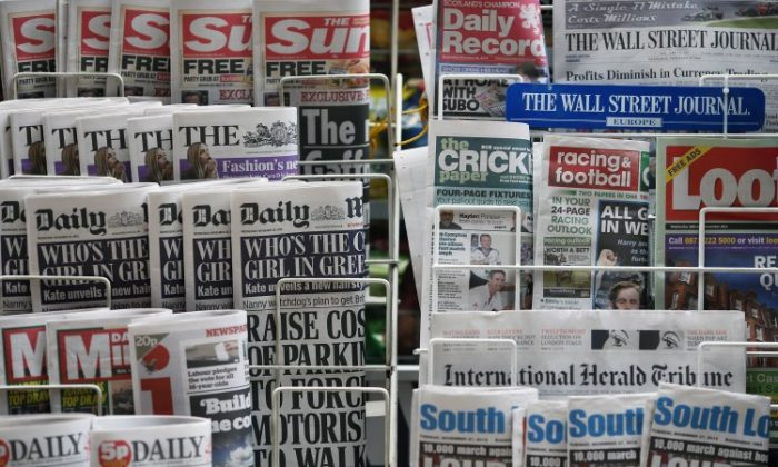 Newspapers are displayed on a stand outside a newsagent on Nov. 28, 2012 in London, England. British politicians reached a deal on contentious press regulations early March 18, 2013. (Dan Kitwood/Getty Images)