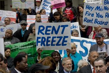 Tenants and officials protest  against rent increases in front of City Hall. (The Epoch Times)
